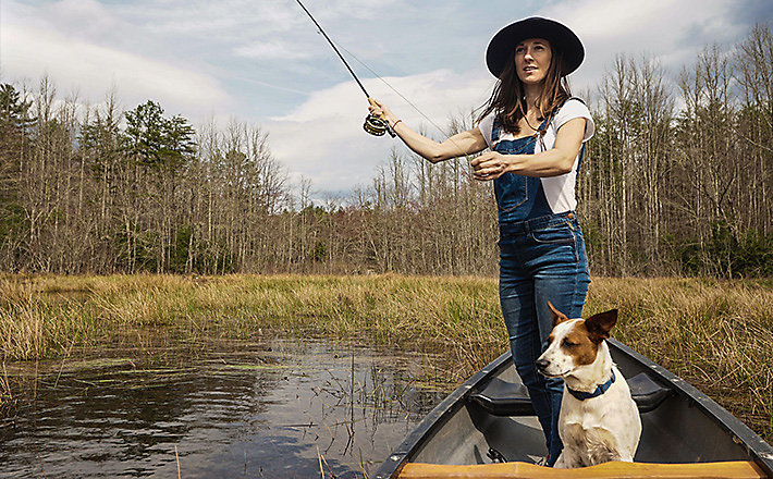 Katie Cahn fishing from canoe - The Great Spirit | Legends