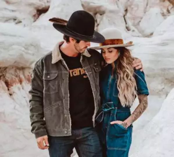 man and women wearing Wrangler clothing