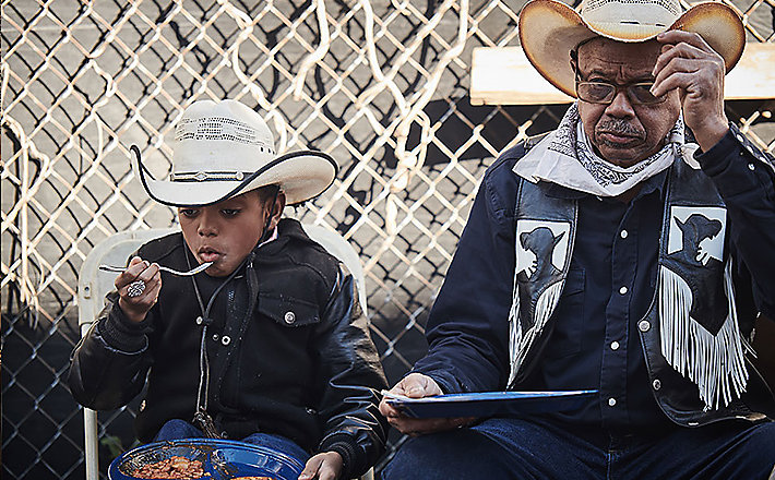 "Federation of Black Cowboys | Legends - Long-time FBC member ""Curly"" and his grandson. Curly maintains the horses the FBC uses for youth programs and is actively working to build a museum of African-American cowboy history in hopes to pass down this knowledge to future generations."